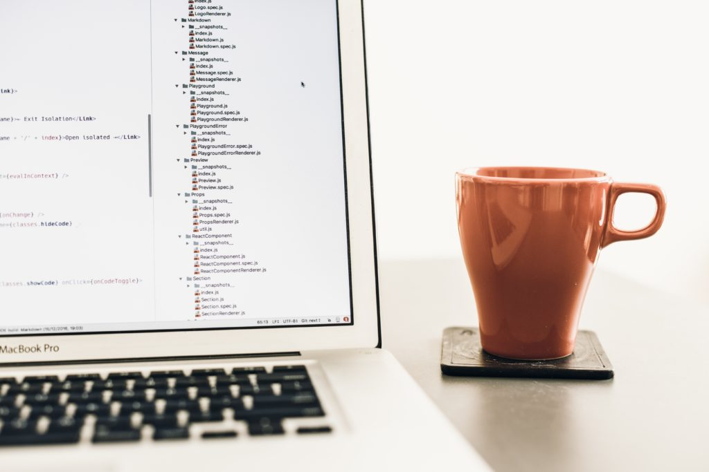 coding screen with mug