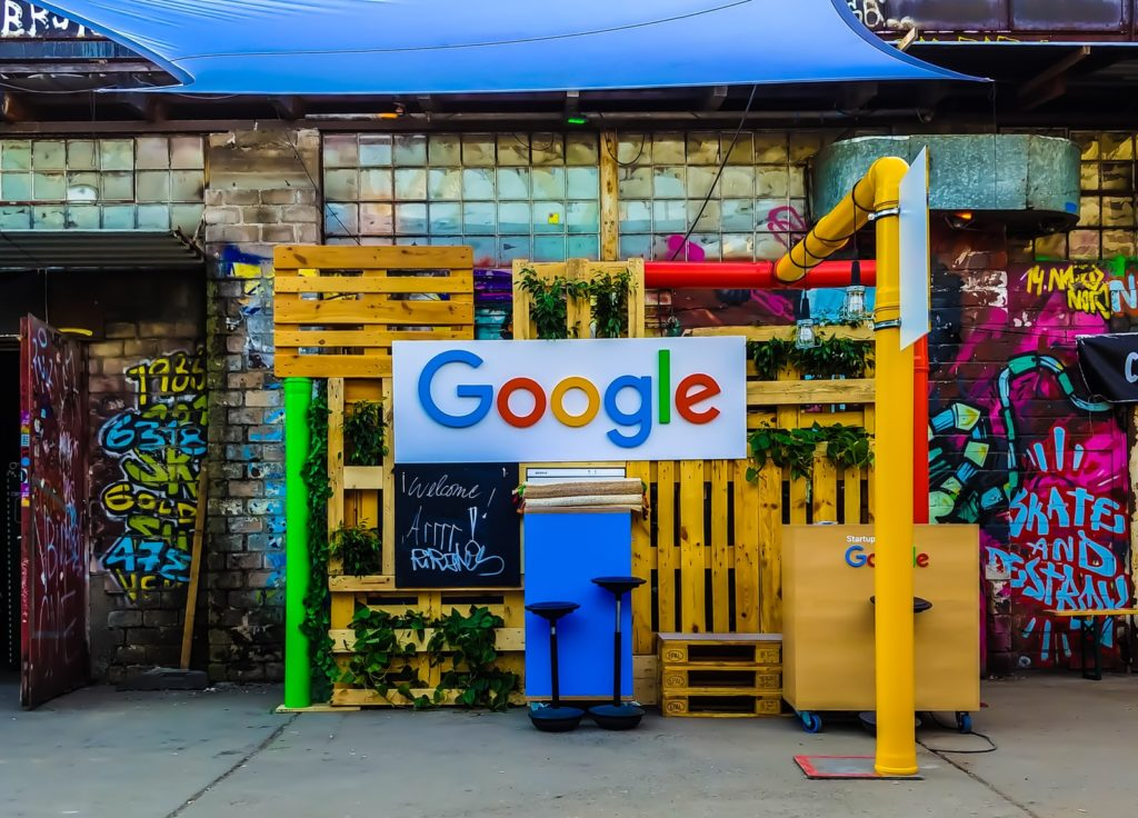 Google sign in front of a colorful building
