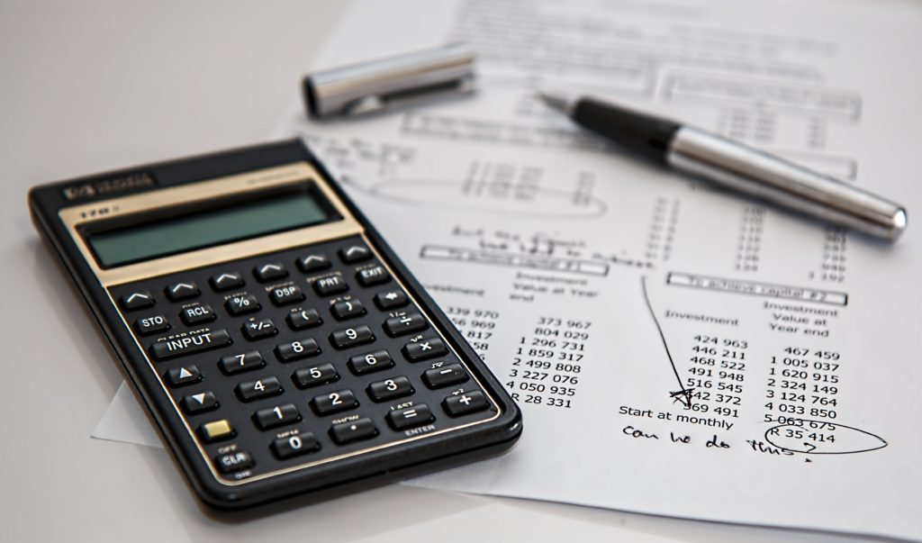 calculator on document to assess budget