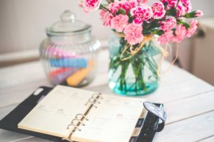 Scheduling calendar with flowers