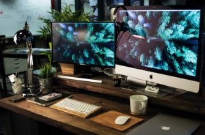 two large computer screen monitors