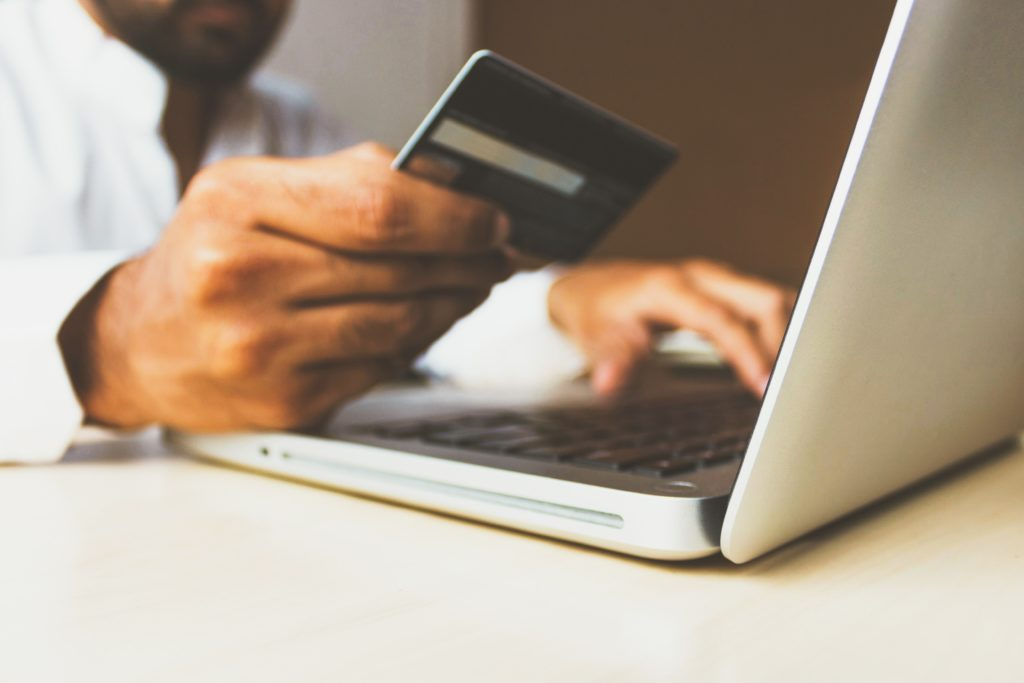 person with credit card purchasing online